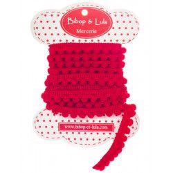 Ruban pompon rouge