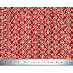 Tissu coton rouge carmin avec motifs