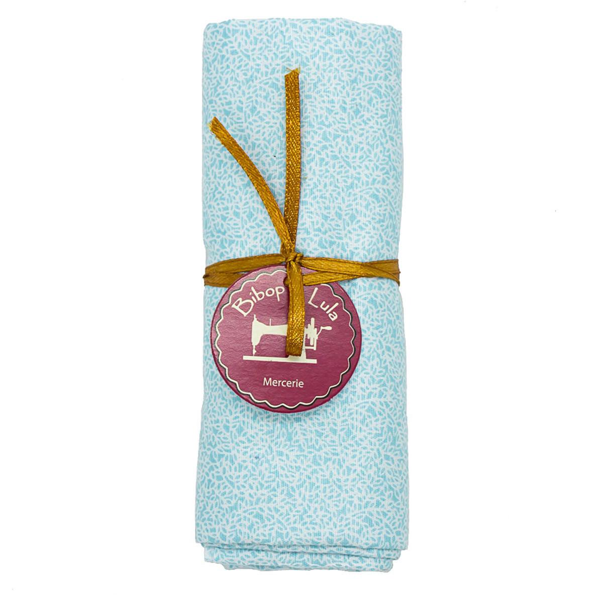coupon tissu coton mini feuilles blaches sur fond bleu ciel
